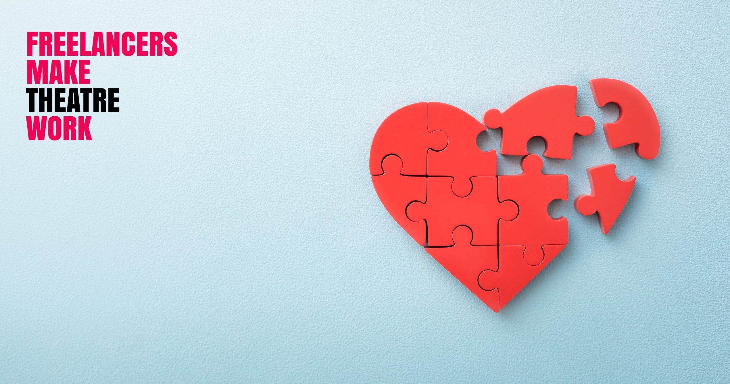 A red heart made of jigsaw pieces