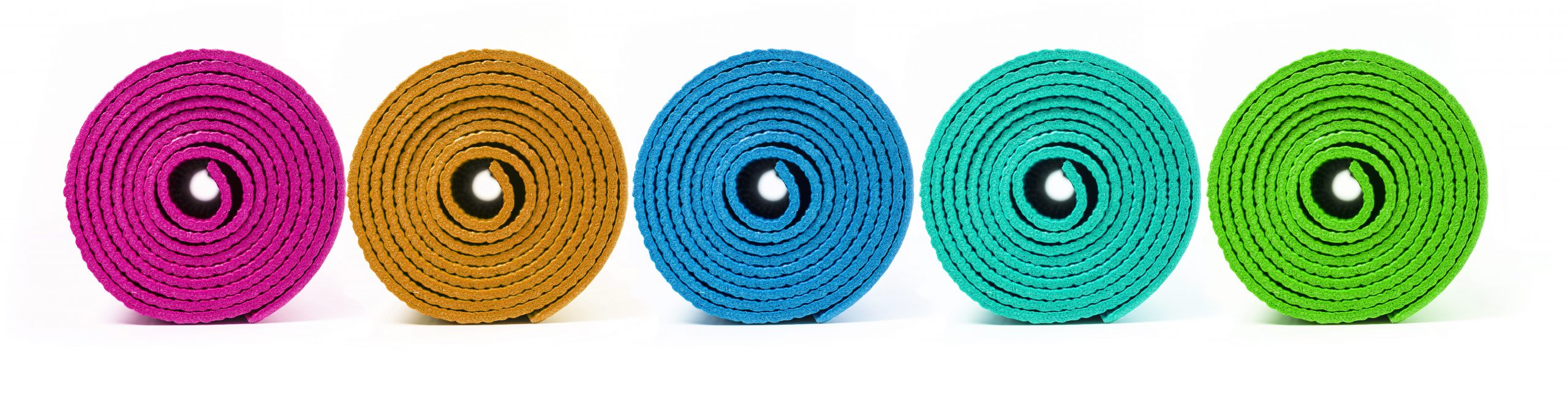 A row of rolled up yoga mats